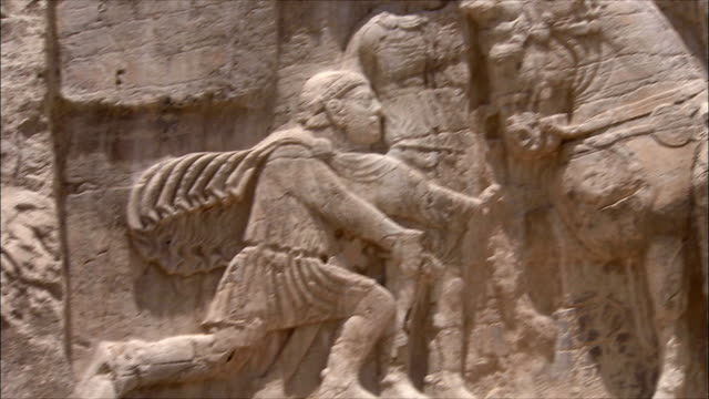 cu pan bas relief depicting royal figure on horseback, near persepolis, iran - bas relief stock videos & royalty-free footage