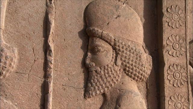 cu zi bas relief depicting soldier, persepolis, iran - bas relief stock videos & royalty-free footage