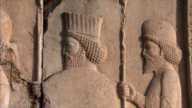 cu pan bas relief depicting soldiers with spears, persepolis, iran - iran stock videos and b-roll footage