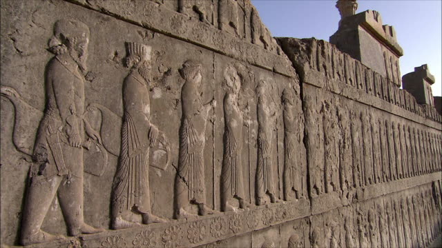 ms tu td bas relief depicting soldiers with spears, persepolis, iran - stone object stock videos and b-roll footage