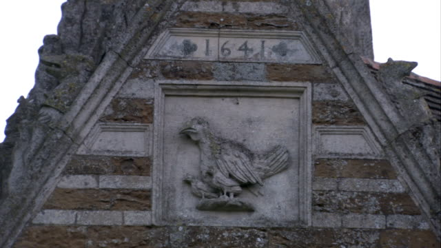 a bas relief game bird decorates the limestone facade of the rushton triangular lodge. available in hd. - bas relief stock videos & royalty-free footage