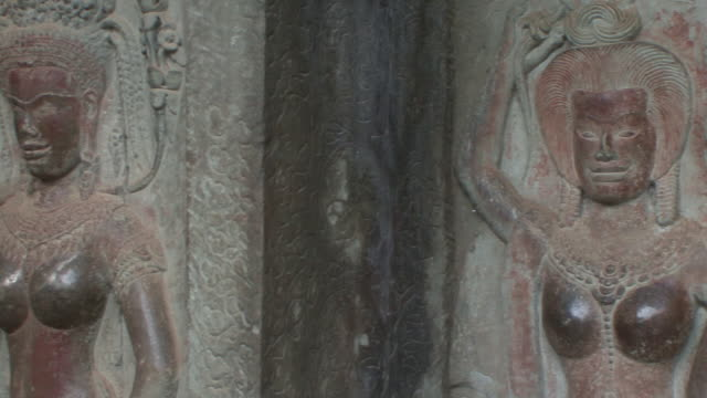 cu pan bas relief of four female deities / siem reap, cambodia  - bas relief stock videos & royalty-free footage