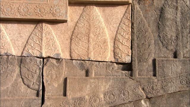 cu pan bas relief with leaf pattern, persepolis, iran - bas relief stock videos & royalty-free footage