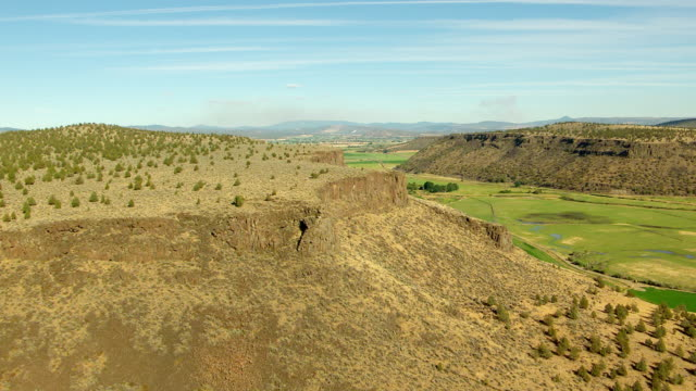 ms aerial basalt cliff with farmland / oregon, united states - basalt stock videos & royalty-free footage