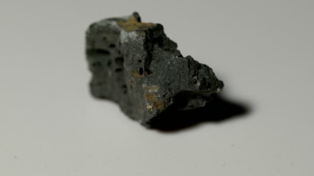 basalt mineral sample in rotation with white background - igneous stock videos & royalty-free footage