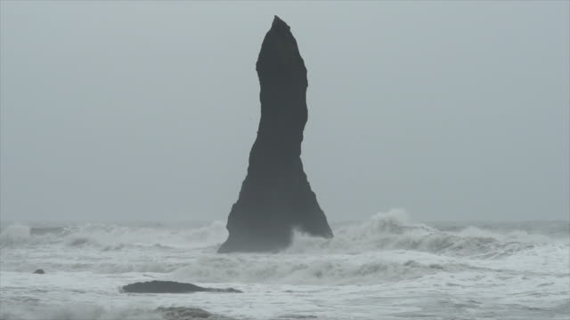 basalt stack columns at reynisdrangar, iceland, europe. - slow motion - iceland stock videos & royalty-free footage