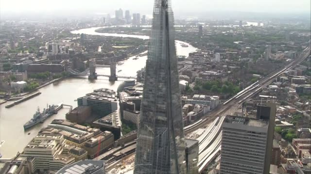 base jumper leaps from the shard; lib / 11.6.2015 air view / aerial the shard - base jumper stock videos & royalty-free footage