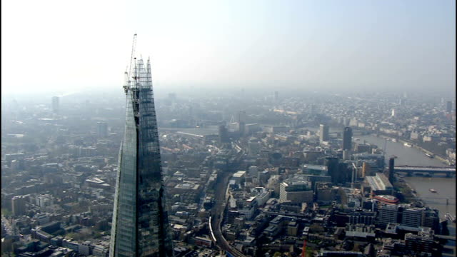base jumper parachutes off the shard four times; day air view of 'the shard' building under construction - base jumper stock videos & royalty-free footage