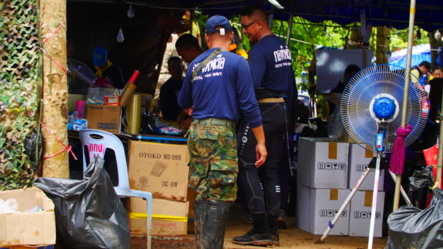 base of rescue operations outside the cave network where boys among a group of 13 trapped in a flooded cave in khun nam nang non forest park in the... - chiang rai province stock videos and b-roll footage