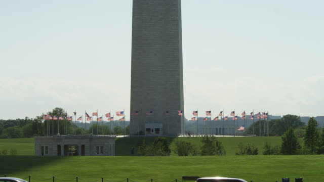 Base of the Washington Monument, traffic in foreground. Shot in May 2012.