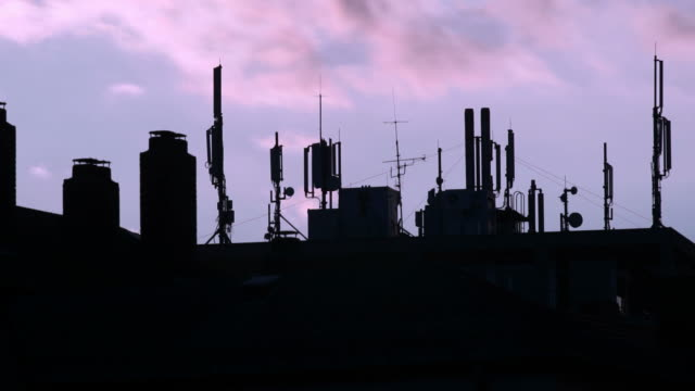 t/l base station antennas against purple sky - stimmungsvoller himmel stock videos & royalty-free footage