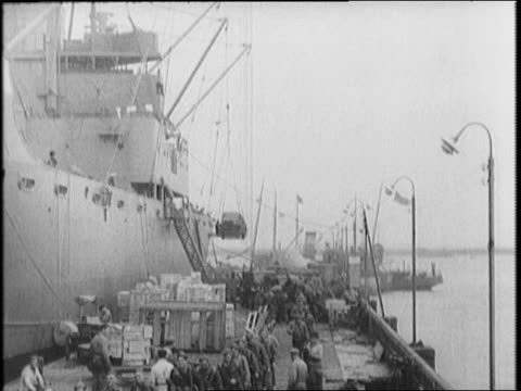US base with Marines US Army at Reykjavik / damaged warships in Reykjavik Harbor / cargo arrives for US Marines / food and supplies unloaded for...