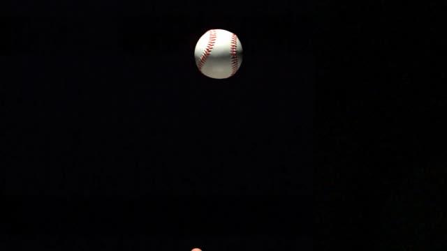 Baseball ball rotating in the air