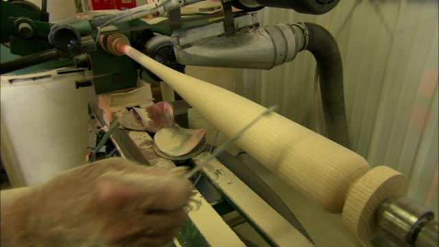 a baseball bat manufacturer uses calipers to measure the width of a bat. - calliper stock videos and b-roll footage