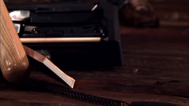 a baseball bat pounds a printer, destroying it. - baseball bat stock videos & royalty-free footage