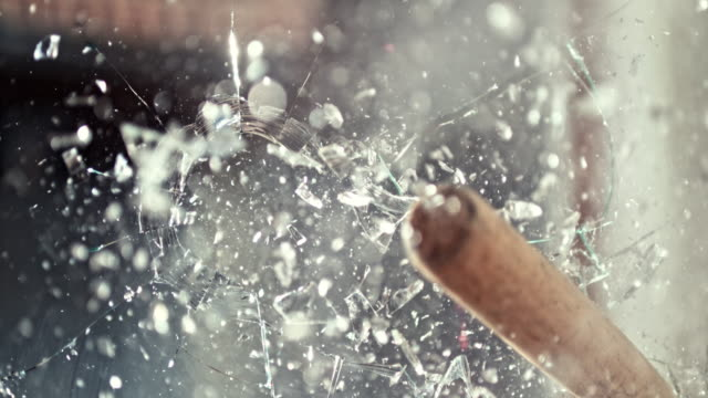 SLO MO LD Baseball bat smashing a glass window