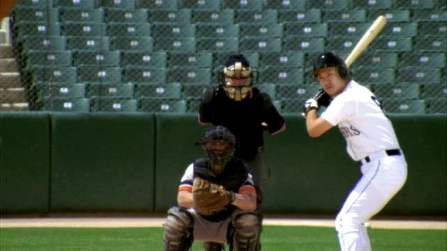 SLO MO MS Baseball batter, catcher and umpire in home base in stadium / Lancaster, California, USA