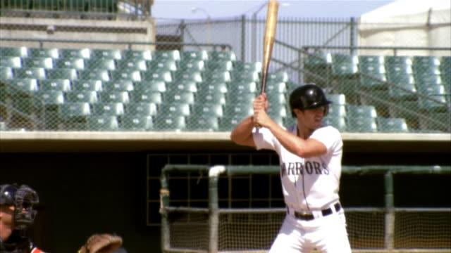 slo mo ms baseball batter hitting ball in stadium / lancaster, california, usa - バッティング点の映像素材/bロール