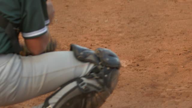 a baseball catcher makes a play at a game. - 野球用グローブ点の映像素材/bロール