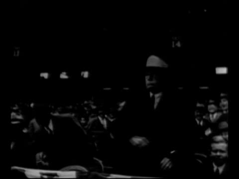 Baseball commissioner Kenesaw Mountain Landis tips his hat to camera talks to St Louis Cardinals players at game 6 of the 1926 World Series at Yankee...