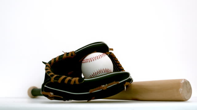 baseball falling in baseball gloves - 野球用グローブ点の映像素材/bロール