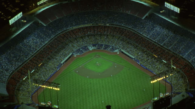baseball fans attend a night game at dodger stadium in los angeles. - baseball diamond stock videos and b-roll footage