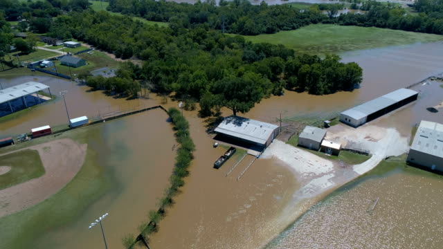 baseball fields , parks , and schools , flooded in Columbus , Texas after Hurricane Harvey Drone view of Flooded Colorado River