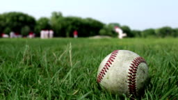 Baseball Game from Grass - Batter Hits Pitch and Running