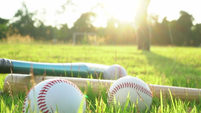 baseball game from grass - batter hits pitch - baseball bat stock videos & royalty-free footage
