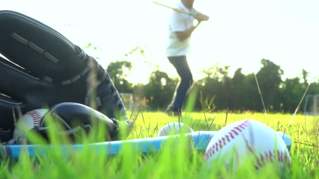 baseball game from grass - batter hits pitch - baseball diamond stock videos and b-roll footage