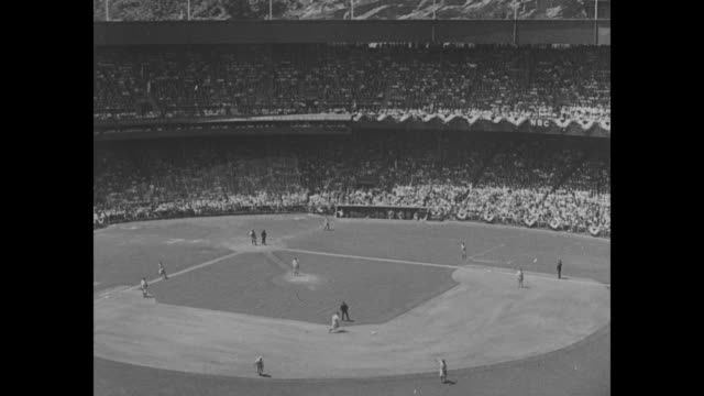Baseball game in progress at Yankee Stadium in New York / player hits runs / CU New York Yankees baseball game ticket showing price amount of tax and...