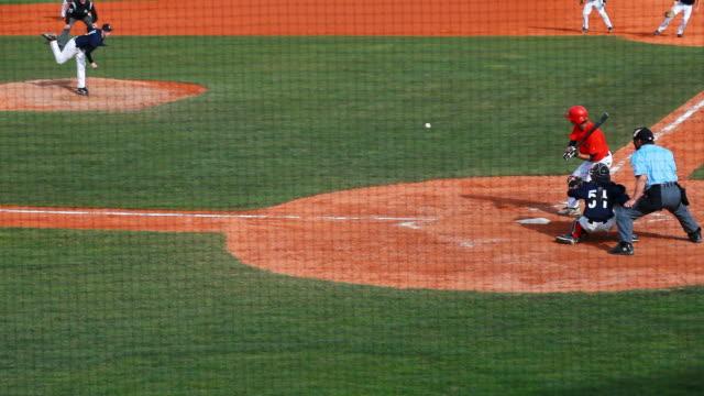 slo mo baseball infield scene - einen baseball schlagen stock-videos und b-roll-filmmaterial