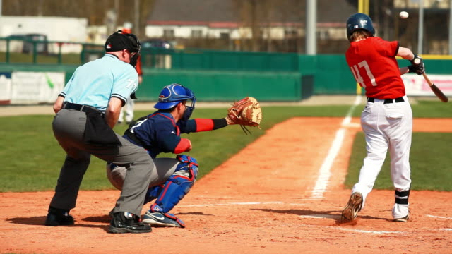 baseball junior match infield scene - batting stock videos & royalty-free footage