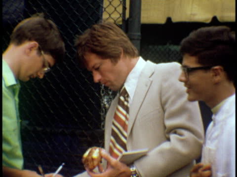 1974 ms baseball legend jim bouton signing autographs at the us open tennis championship at forest hills west side tennis club / queens, new york - autographing stock videos & royalty-free footage