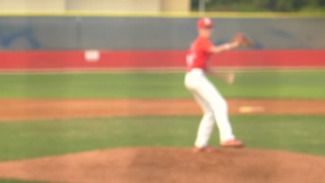 a baseball pitcher pitching to catcher, batter swinging at a game. - batting stock videos & royalty-free footage
