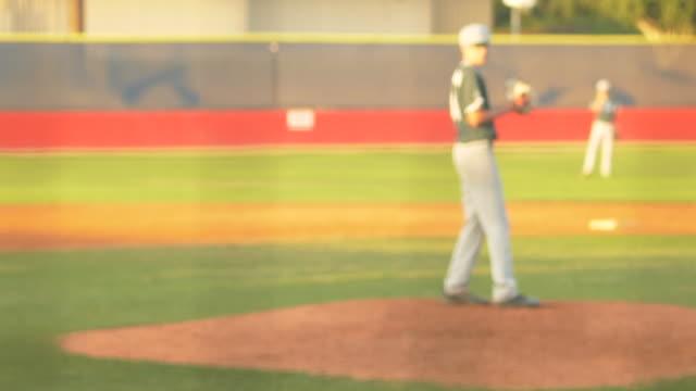 a baseball pitcher pitching to catcher, batter swinging at a game. - 野球用グローブ点の映像素材/bロール