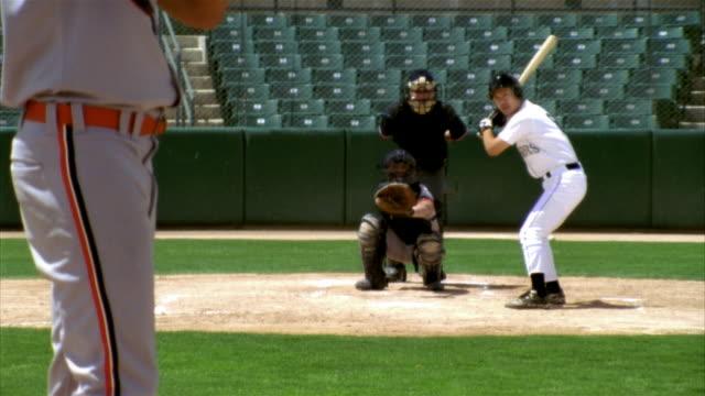 slo mo ms baseball pitcher throwing ball, batter, catcher and umpire in home base in stadium / lancaster, california, usa - baseballmannschaft stock-videos und b-roll-filmmaterial