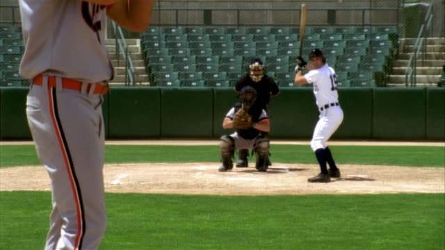 slo mo ms baseball pitcher throwing ball, batter, catcher and umpire in home base in stadium / lancaster, california, usa - baseball pitcher stock videos and b-roll footage