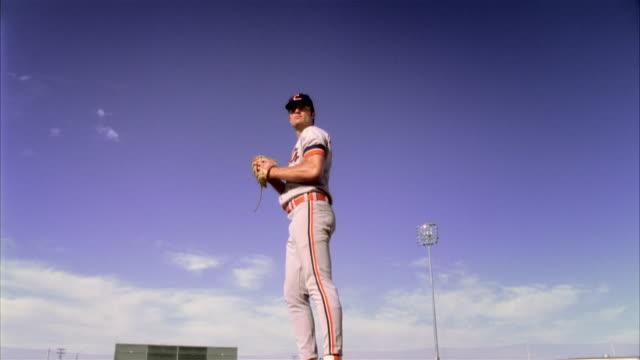 slo mo la ms baseball pitcher throwing baseball / lancaster, california, usa - baseball pitcher stock videos and b-roll footage