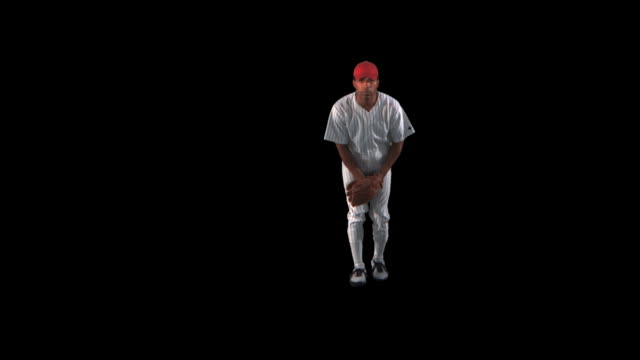 baseball pitcher throwing - this clip has an embedded alpha-channel - basebollpitcher bildbanksvideor och videomaterial från bakom kulisserna