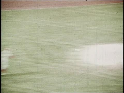 baseball player bunting and running to first base while dagoberto campanera steals third base / united states - skakig kamerabild bildbanksvideor och videomaterial från bakom kulisserna