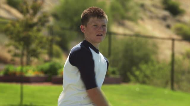 slo mo ms baseball player (12-13) catching ball, american fork, utah, usa - 野球用グローブ点の映像素材/bロール