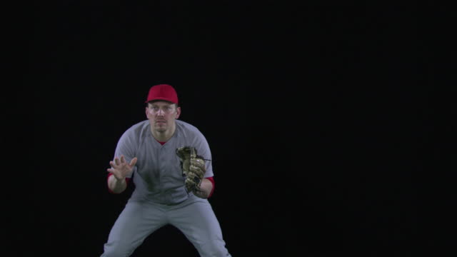 MS SLO MO Baseball player catching ball and then pivoting to left / Berlin, Germany