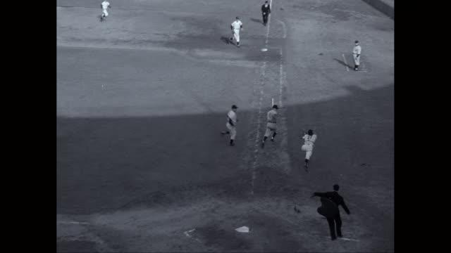 MS Baseball player catching baseball in baseball diamond / United States