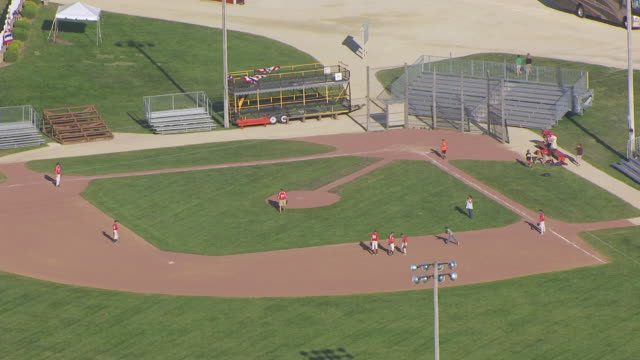 WS AERIAL POV Baseball player catching practice in baseball field / Dubuque County, Iowa, United States
