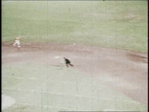 ts baseball player hits a pitch and the player on third slips while running home / united states - 1972 stock videos and b-roll footage