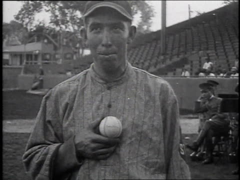 montage baseball player holding a baseball signed by woodrow wilson /united states - 1916 stock videos & royalty-free footage