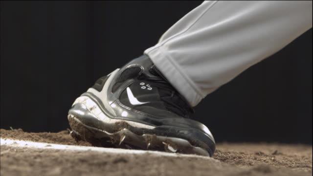 CU SLO MO Baseball player lifting leg  / Thousand Oaks, California, USA
