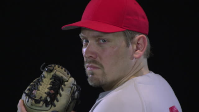 cu slo mo baseball player pitching ball / berlin, germany - baseballspieler stock-videos und b-roll-filmmaterial