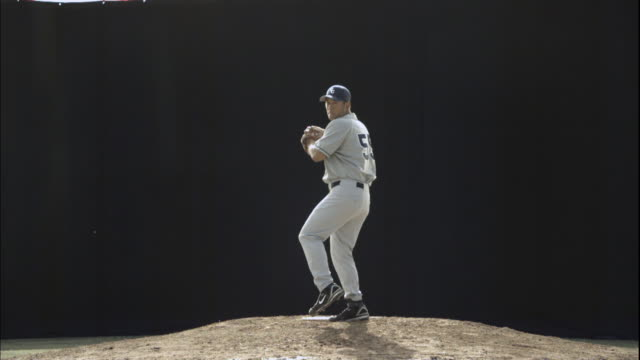 stockvideo's en b-roll-footage met ws slo mo baseball player pitching ball / thousand oaks, california, usa - honkbal teamsport